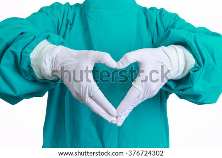 Heart shape hands of surgeon doctor in the green gown on white blackground #376724302