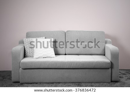 Grey comfortable sofa against white wall in the room #376836472