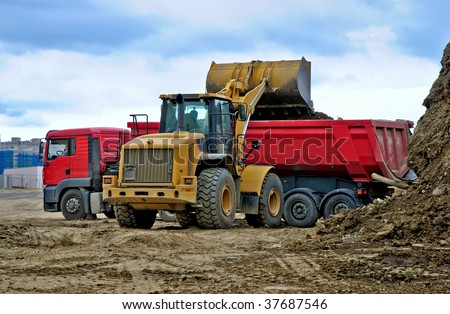Works in industrial zone. Excavator is loading ground to track #37687546