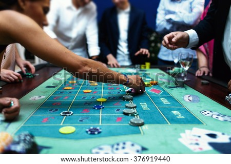 People playing poker in the casino, roulette, gambling Royalty-Free Stock Photo #376919440