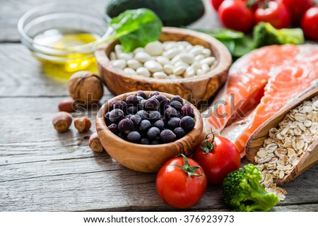 Selection of food that is good for the heart, rustic wood background Royalty-Free Stock Photo #376923973