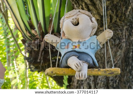 close up,old happy dolls for garden decoration #377014117