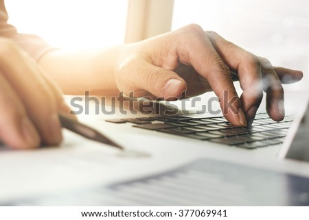 close up of businessman hand working with new modern computer #377069941