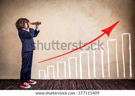 Portrait of young businessman kid in office. Success business strategy concept #377115409