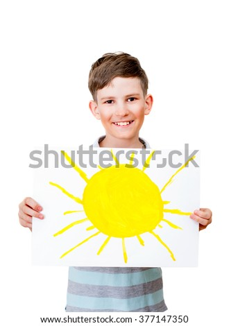 A teenage boy is holding picture of sun, isolated on white background