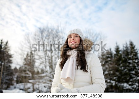 people, season and leisure concept - happy woman outdoors in winter #377148508