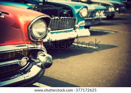 Classic cars in a row Royalty-Free Stock Photo #377172625