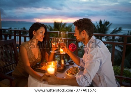 young couple enjoying a romantic dinner by candlelight, outdoor #377401576