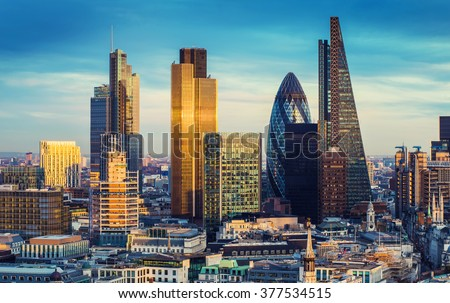London, England - The bank district of central London with famous skyscrapers and other landmarks at sunset with blue sky - UK Royalty-Free Stock Photo #377534515