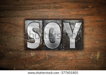 """The word """"Soy"""" written in vintage metal letterpress type on an aged wooden background. #377601805"""