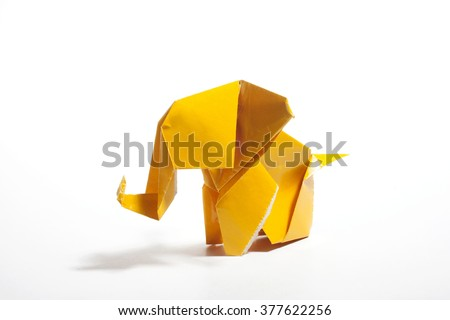 Yellow origami elephant  isolated on white background
