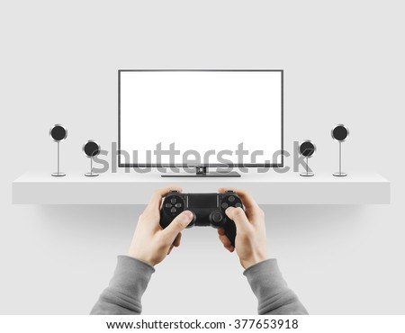 Man hold gamepad in hands in front of blank tv screen mock up playing game. Clear monitor mockup with gamer first person. Video gaiming console screen display. Gamer play game pad on tv screen. Royalty-Free Stock Photo #377653918