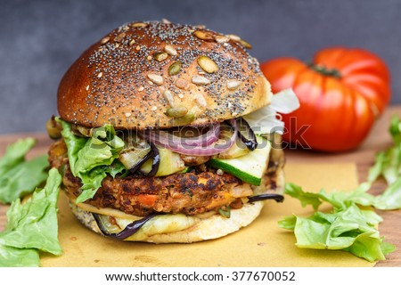 Close-Up Of Veggie Burger On Cutting Board #377670052
