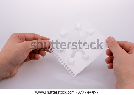 Hand holding paper art on a white background #377744497