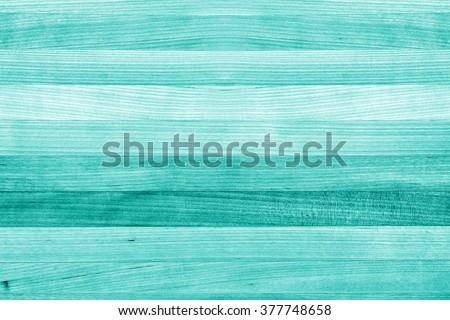 Teal or turquoise green painted wood background texture
