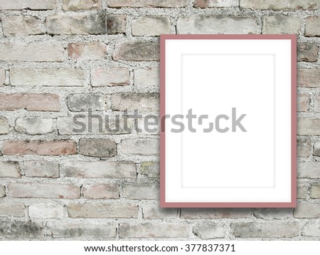 Close-up of one pink picture frame on weathered brick wall background