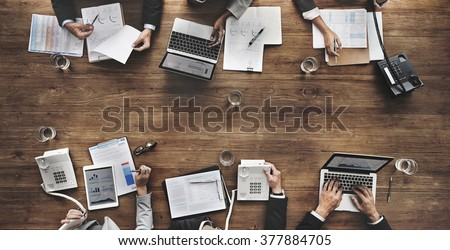Business People Analyzing Statistics Financial Concept Royalty-Free Stock Photo #377884705