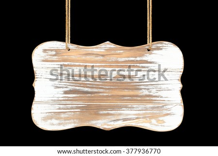 close up of an empty wooden sign hanging on a rope on black background