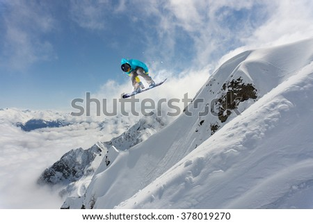 Flying snowboarder on mountains. Extreme sport. #378019270