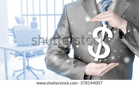 businessman protecting dollar symbol #378144007