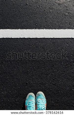 Shoes dirty sneakers blue on new white line asphalt road top view focus on road #378162616