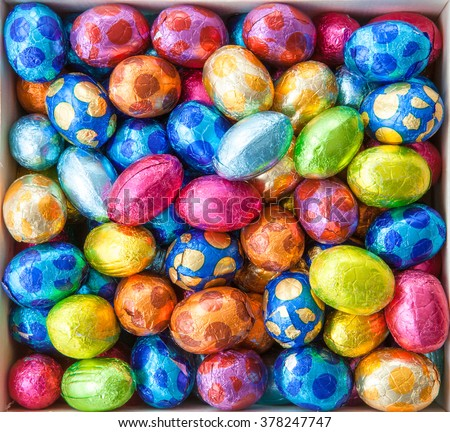 Chocolate eggs in colorful foil for easter Royalty-Free Stock Photo #378247747
