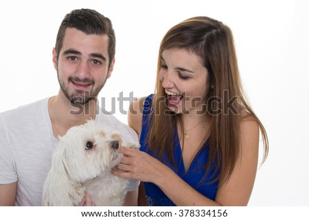 Couple in love with a white dog  isolated on white #378334156