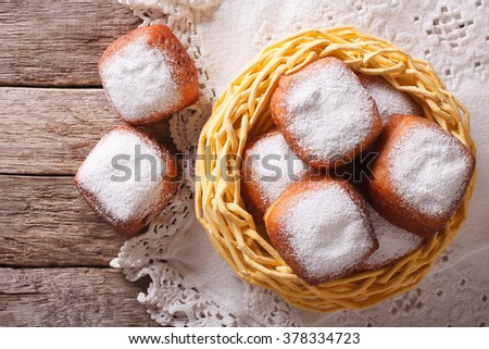 fried donuts square beignets in the basket on the table. Horizontal top view #378334723