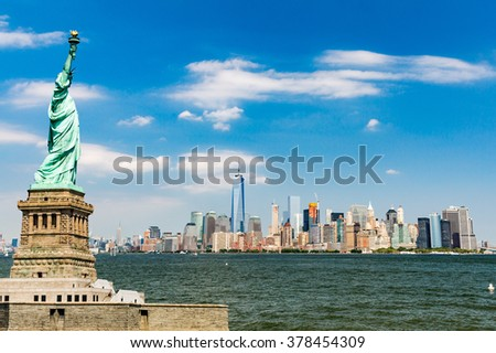 View to Downtown Manhattan and the USA flag from Liberty Island, August 2015