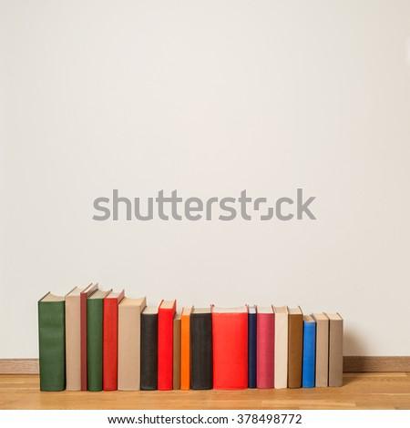 Old books on wooden floor #378498772