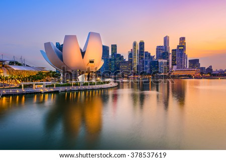 Singapore skyline at the Marina during twilight. Royalty-Free Stock Photo #378537619