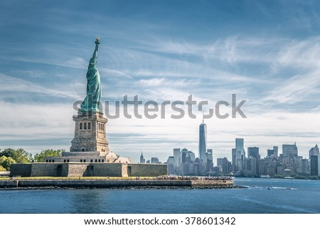 The statue of Liberty and Manhattan, New York City Royalty-Free Stock Photo #378601342