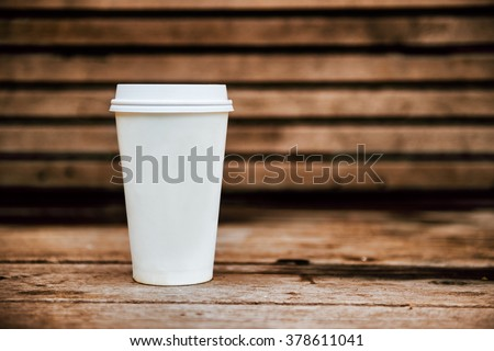 Paper coffee cup from coffee shop on wooden background #378611041