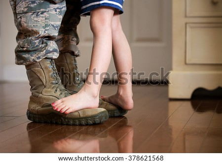 Dancing with daddy before deployment Royalty-Free Stock Photo #378621568