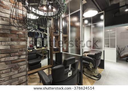 The Interior of modern(organic, vintage, natural) hair salon(beauty parlor, hairdresser's) with chair, red brick, marble bottom #378624514