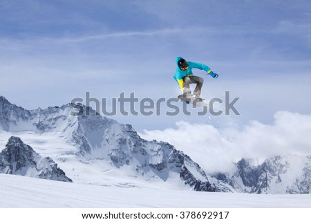 Flying snowboarder on mountains. Extreme sport. #378692917
