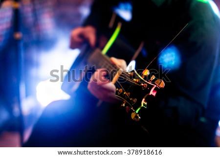 Playing guitar Royalty-Free Stock Photo #378918616