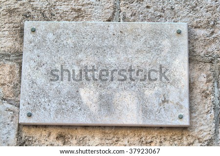 marble sign on the old stone wall #37923067