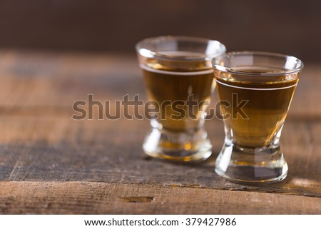 bourbon whiskey in glass on wooden background #379427986