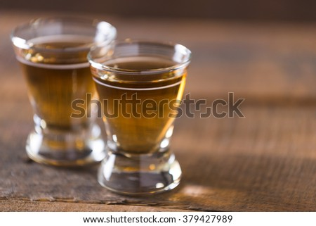 bourbon whiskey in glass on wooden background #379427989