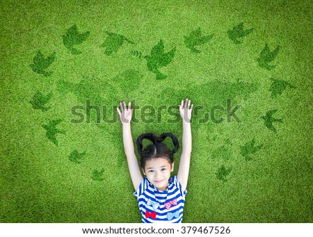 World peace day, international day of peace, and universal children's day concept with peaceful mind kid resting in clean natural environment on eco friendly world map green lawn #379467526