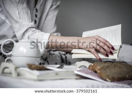 Women hand flipping through a book  #379502161