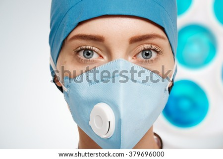 face of a woman doctor in a mask #379696000