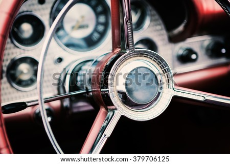 Classic car interior with close-up on steering wheel #379706125