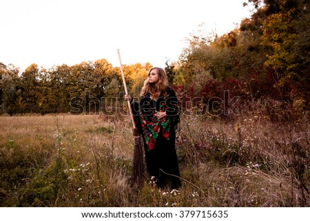 oung girl dressed in a fall Halloween witch  #379715635