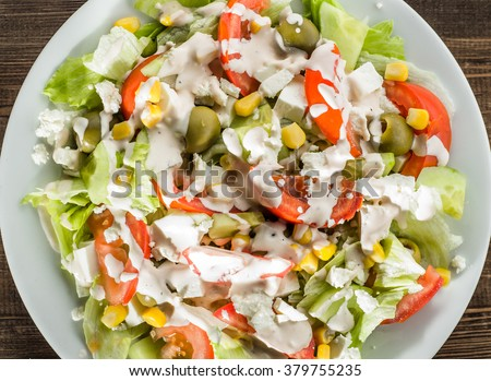 Colorful vegetable salad with tomato and lettuce. #379755235