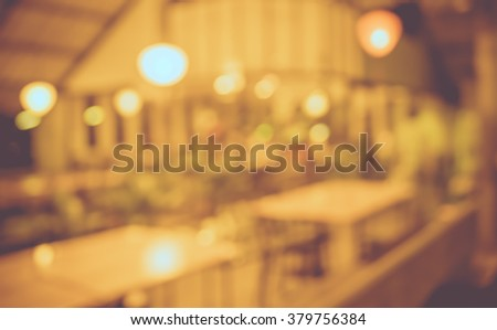 image of blur restaurant in night time for background usage . (vintage tone) #379756384