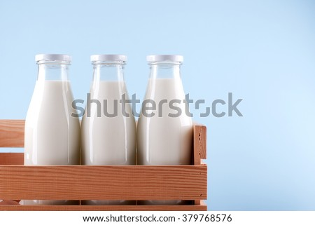 milk bottle in the box Royalty-Free Stock Photo #379768576