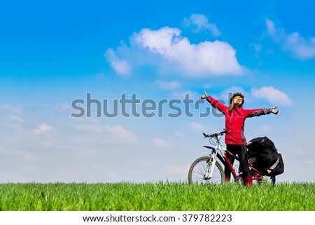 Girl cyclist with bike relax view panorama in sunny spring park  #379782223