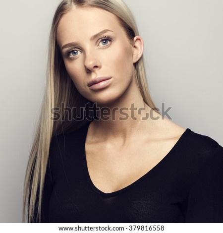Portrait of a casual blonde woman in black top #379816558